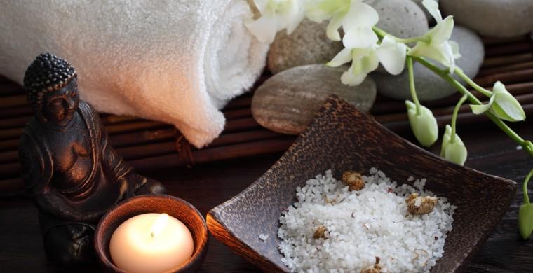 Closeup of aromatic candle,buddha,towel and sea salt.